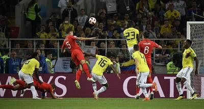 MOSCOW, July 3, 2018 (Xinhua) -- Harry Kane (2nd L) of England is fouled by Carlos Sanchez (1st L) of Colombia resulting in a penalty during the 2018 FIFA World Cup round of 16 match between England and Colombia in Moscow, Russia, July 3, 2018. (Xinhua/Lui Siu Wai/IANS)