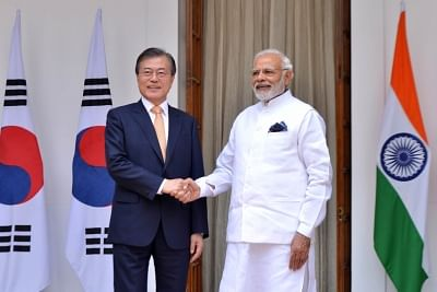 New Delhi: Prime Minister Narendra Modi and South Korean President Moon Jae-in head for a meeting at Hyderabad House, in New Delhi on July 10, 2018. (Photo: IANS)
