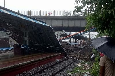 Mumbai: The site where a section of a foot overbridge caved in over the Western Railway (WR) tracks following incessant rain, leaving five persons injured, and creating a scare among the commuters in Mumbai, on July 3, 2018. (Photo: Sandeep Mahankal/IANS)