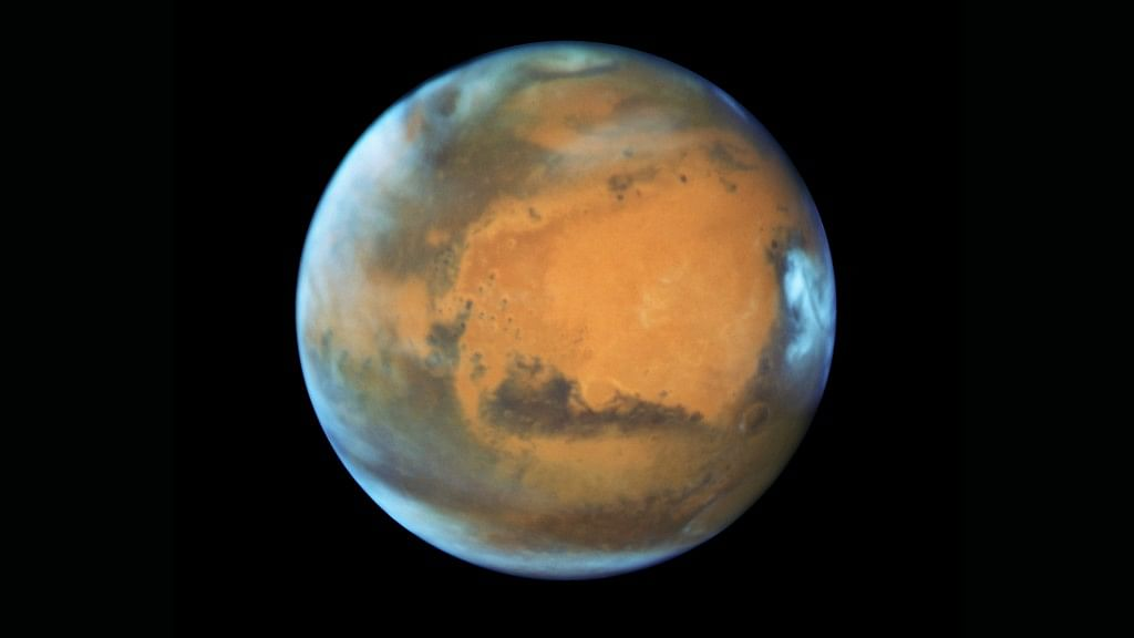 A study published on Wednesday, 25 July, in the journal Science suggests a huge lake of salty water appears to be buried deep in Mars, raising the possibility of finding life on the red planet.