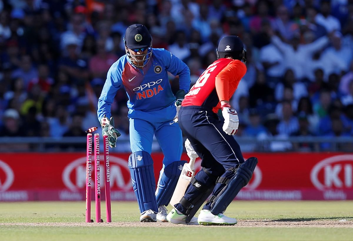 MS Dhoni picks off Joe Root's bails to send him back to the pavilion.