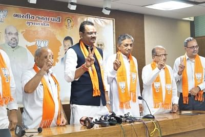 Gandhinagar: Rajasthan BJP chief Jitubhai Vaghani with former Congress MLA and prominent Koli community leader Kunwarji Bawalia at the party headquarter, in Gandhinagar on July 3, 2018. Accusing Congress President Rahul Gandhi of playing caste politics and ignoring the aspirations of senior leaders, Bawalia on Tuesday quit as a legislator to join the ruling BJP. He will be sworn in as a minister in the state cabinet later in the evening. (Photo: IANS/Twitter/@BJP4Gujarat)