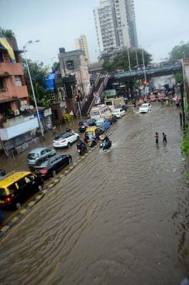 Mumbai: A view of the flooded streets as heavy rains continued to batter Mumbai for the fourth day, on July 10, 2018. Areas like Dahisar, Borivali, Malad, Jogeshwari, Andheri, Santacruz, Mahim, Kurla, Parel, Dadar, Chembur, King Circle, Sion, Wadala, Masjid Bunder, Ghatkopar, Powai, Bhandup and others experienced heavy waterlogging, impeding traffic and pedestrian movement. (Photo: IANS)