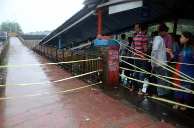 Mumbai: The bridge on Grant Road station of Western Railway closed as heavy rains continued to batter Mumbai for the fourth day, on July 10, 2018. Areas like Dahisar, Borivali, Malad, Jogeshwari, Andheri, Santacruz, Mahim, Kurla, Parel, Dadar, Chembur, King Circle, Sion, Wadala, Masjid Bunder, Ghatkopar, Powai, Bhandup and others experienced heavy waterlogging, impeding traffic and pedestrian movement. (Photo: IANS)