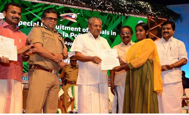 Kerala CM Pinarayi Vijayan and state police chief Loknath Behera at the appointment of 74 Scheduled Tribes members hailing from forest and forest bordering areas.