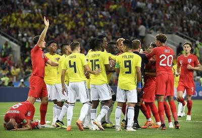 MOSCOW, July 3, 2018 (Xinhua) -- Players of England and Colombia clash during the 2018 FIFA World Cup round of 16 match between England and Colombia in Moscow, Russia, July 3, 2018. (Xinhua/Lui Siu Wai/IANS)