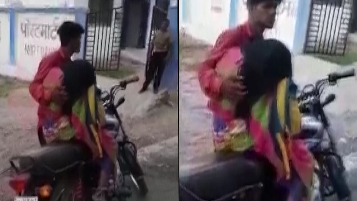 Caught On Cam: Son Forced To Carry Mother's Dead Body On A Bike