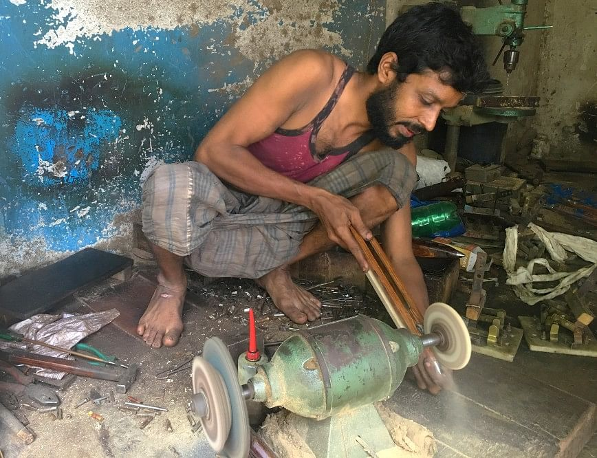 Arshad Ansari makes shuttles used in a loom but has had barely 5 percent sale for the last eight months.