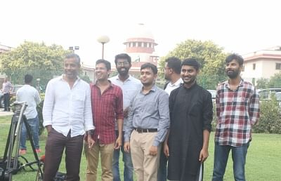New Delhi: Krishna Reddy M, Romel Barel and Anwesh Pokkuluri - the three out of  a batch of 20 current and former students of Indian Institutes of Technology who had filed a petition against Section 377 of the Indian Penal Code that makes homosexuality a crime, outside the Supreme Court, in New Delhi on July 10, 2018. (Photo: IANS)
