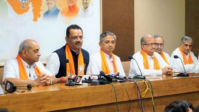 Gandhinagar: Rajasthan BJP chief Jitubhai Vaghani along with former Congress MLA and prominent Koli community leader Kunwarji Bawalia, addresses at the party headquarter, in Gandhinagar on July 3, 2018. Accusing Congress President Rahul Gandhi of playing caste politics and ignoring the aspirations of senior leaders, Bawalia on Tuesday quit as a legislator to join the ruling BJP. He will be sworn in as a minister in the state cabinet later in the evening. (Photo: IANS/Twitter/@BJP4Gujarat)