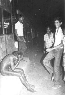 A young Tamil boy stripped naked in the Borella bus stand by Sinhalese mob.