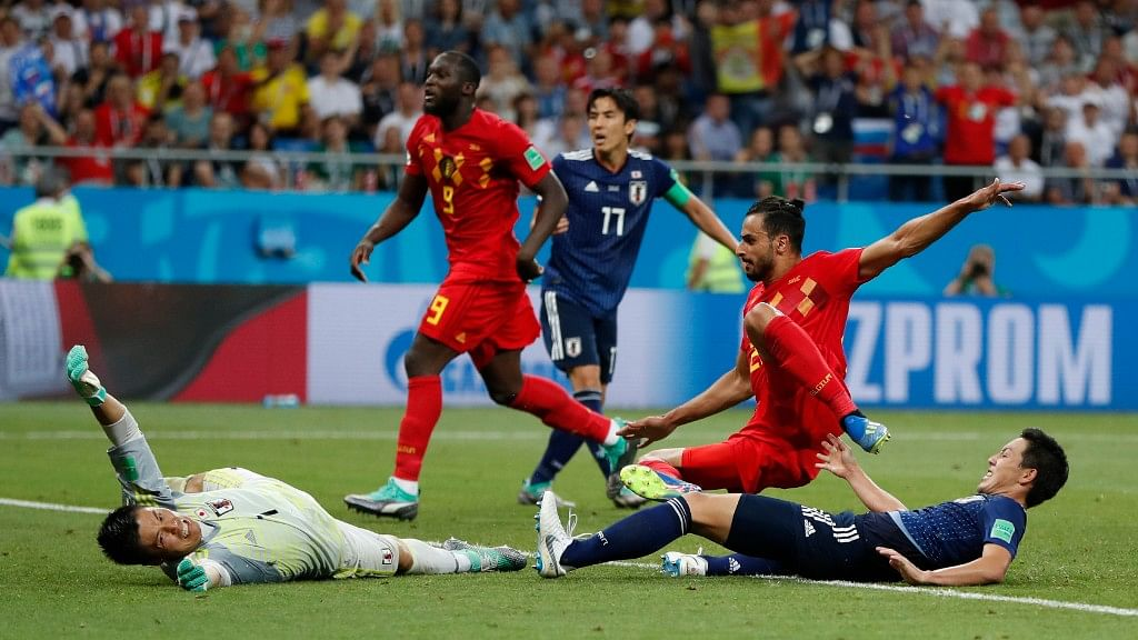 Belgium's Nacer Chadli (second from right) scores his side's third goal past Japan goalkeeper Eiji Kawashima during their Round of 16 at the Rostov Arena on Monday.