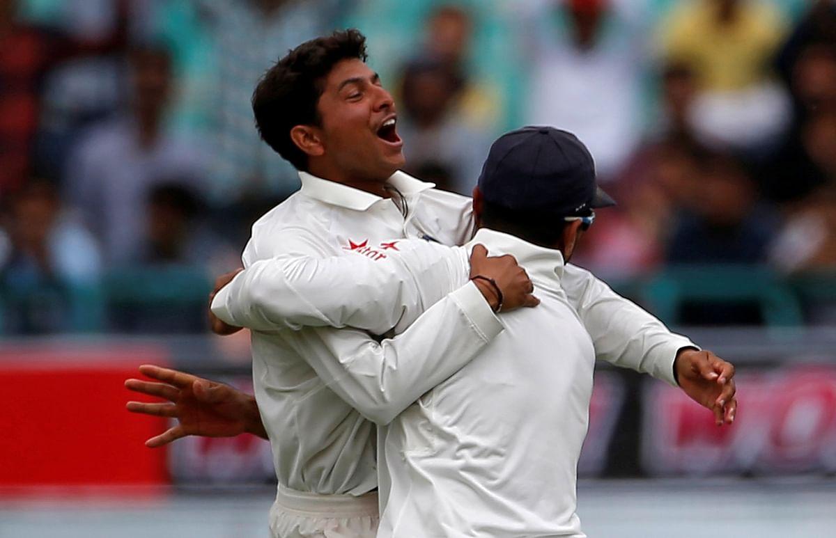 Kuldeep Yadav and Murali Vijay celebrate the dismissal of Australia's Peter Handscomb in the former's first Test match.