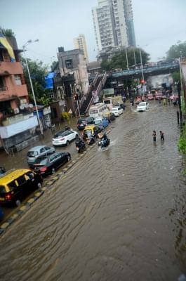 Mumbai: A view of the flooded streets as heavy rains continued to batter Mumbai for the fourth day, on July 10, 2018. Areas like Dahisar, Borivali, Malad, Jogeshwari, Andheri, Santacruz, Mahim, Kurla, Parel, Dadar, Chembur, King Circle, Sion, Wadala, Masjid Bunder, Ghatkopar, Powai, Bhandup and others experienced heavy waterlogging, impeding traffic and pedestrian movement. (Photo: IANS)