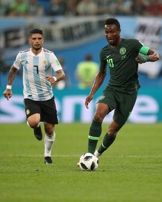SAINT PETERSBURG, June 26, 2018 (Xinhua) -- John Obi Mikel (R) of Nigeria vies with Ever Banega of Argentina during the 2018 FIFA World Cup Group D match between Nigeria and Argentina in Saint Petersburg, Russia, June 26, 2018. (Xinhua/Wu Zhuang/IANS)