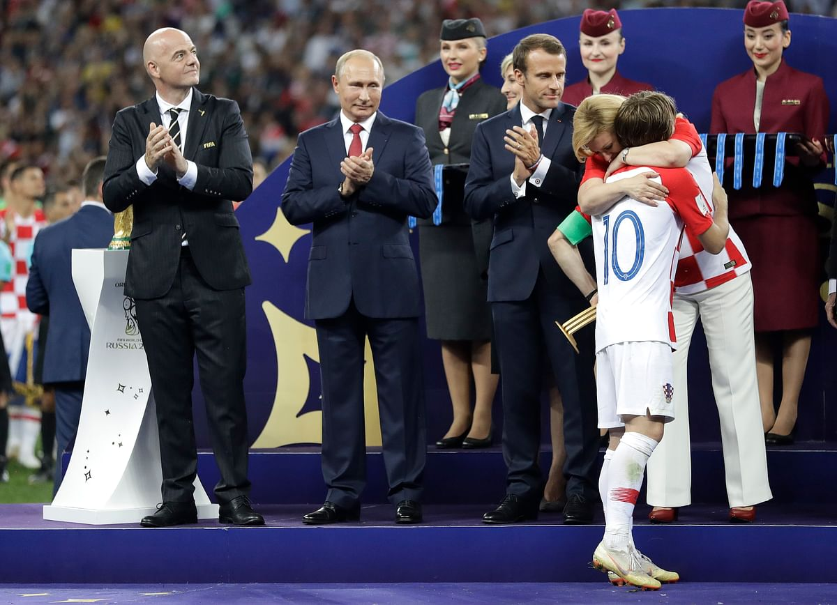 Croatian President Kolinda Grabar-Kitarovic embraces Croatia's Luka Modric after he received the player of the tournament award after the final match between France and Croatia at the 2018 soccer World Cup in the Luzhniki Stadium in Moscow, Russia, Sunday, July 15, 2018. France won the final 4-2