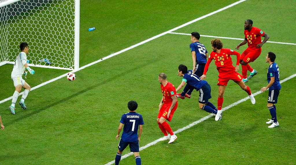 Marouane Fellaini heads the ball past a hapless Eiji Kawashima, the Japanese keeper