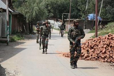 Shopian: Security personnel in action during an encounter with militants in Jammu and Kashmir