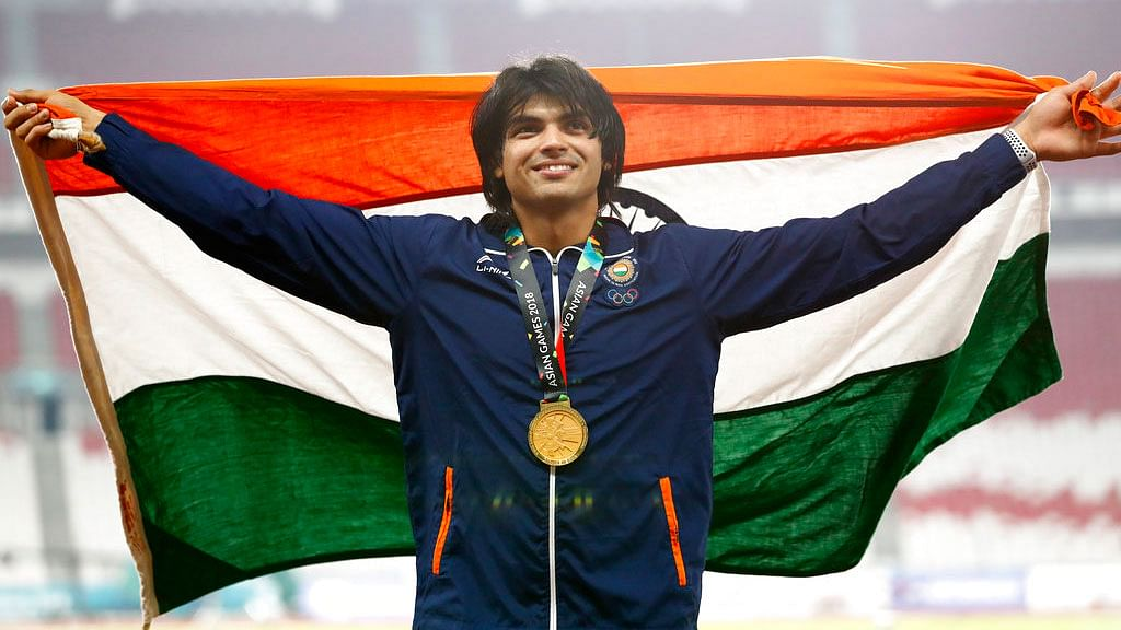 Javelin thrower Neeraj Chopra poses with his Asian Games gold medal.