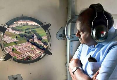 Kodagu: Karnataka Chief Minister HD Kumaraswamy conducts an aerial survey of the flood-hit Kodagu in Karnataka, on 19 August 2018.