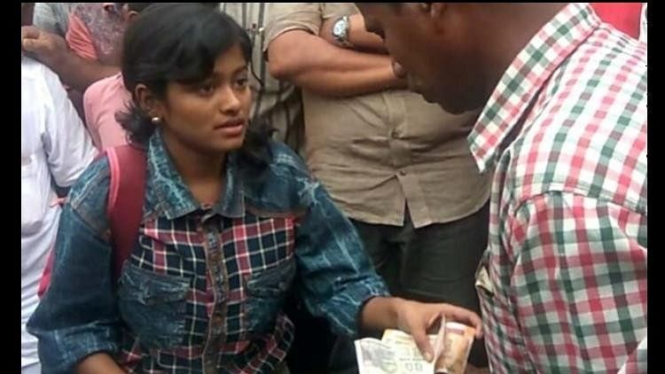 Kerala Girl, Trolled for Selling Fish, Contributes to Flood Relief