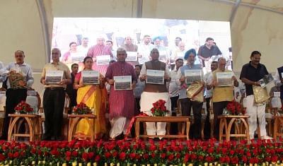 New Delhi: Union Home Minister Rajnath Singh launch Green Colourful New Delhi Municipal Council (NDMC) A Transformational journey book, in New Delhi, on  Aug 13, 2018. Also seen Union Ministers Hardeep Singh Puri, Manoj Sinha, Lieutenant Governor Anil Baijal and BJP MP Meenakshi Lekhi. (Photo: IANS)