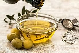 Add virgin olive oil to your salad to beat inflammation.