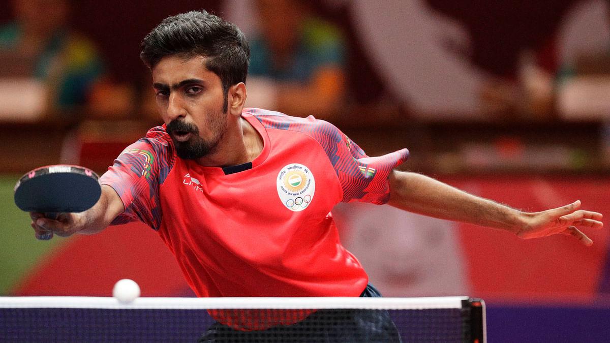 India's Sathiyan Gnanasekaran during their semi-final match against South Korea at the men's team table tennis.