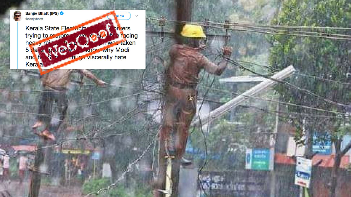 Fake!  Photo of Men Repairing Wires Is Not From Kerala Floods