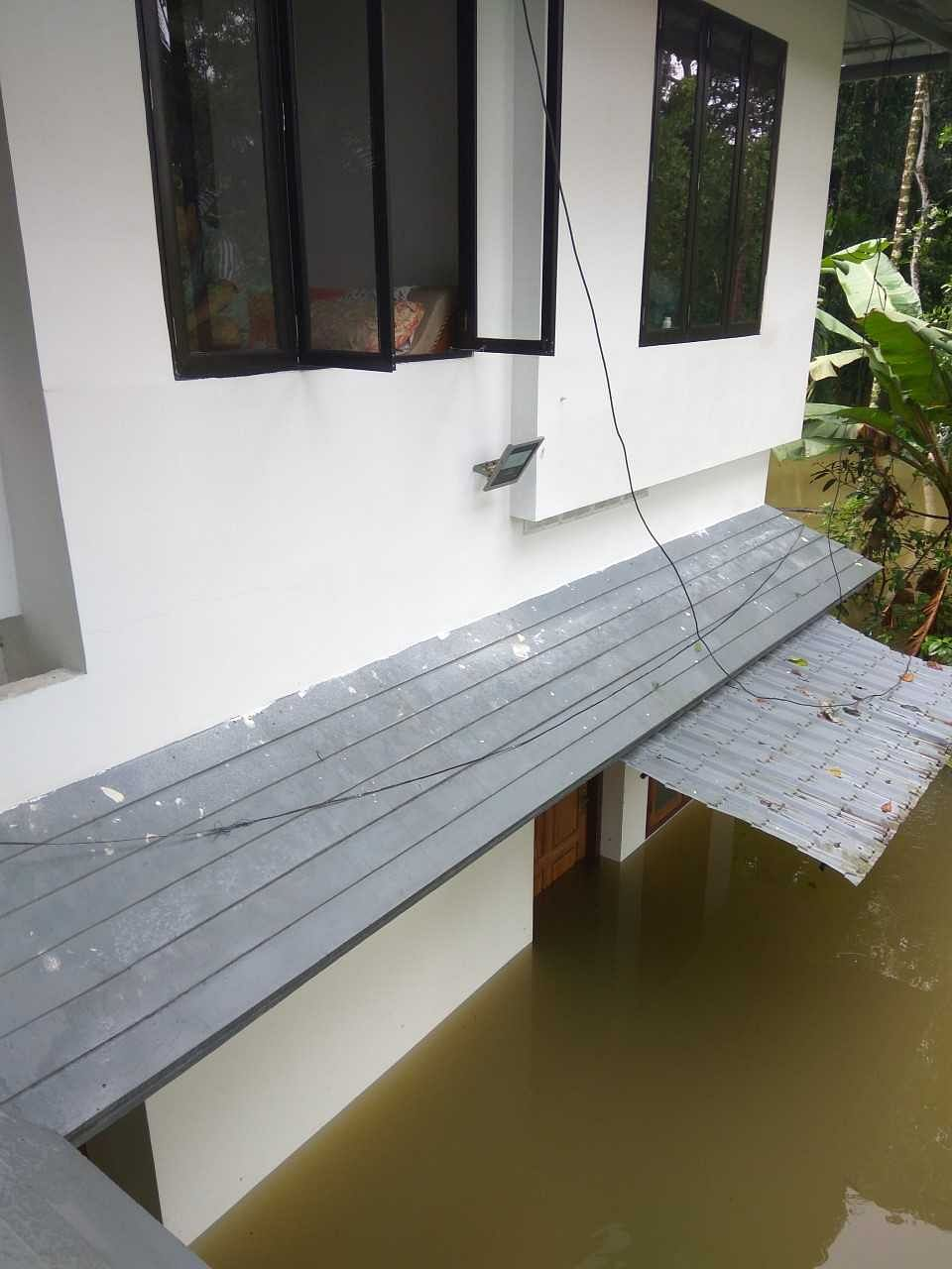 By the end of the day, water had entered the ground floor and we were stranded on the first floor.