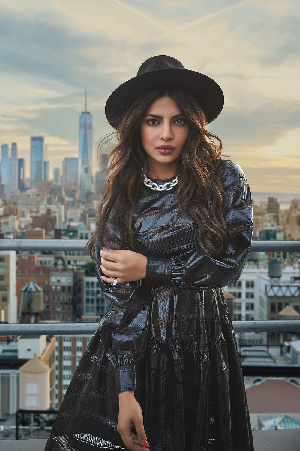 A photograph from Rohan's recent shoot with Priyanka Chopra dressed in a leather ensemble on the roof of a high-rise featuring the skyline of New York.