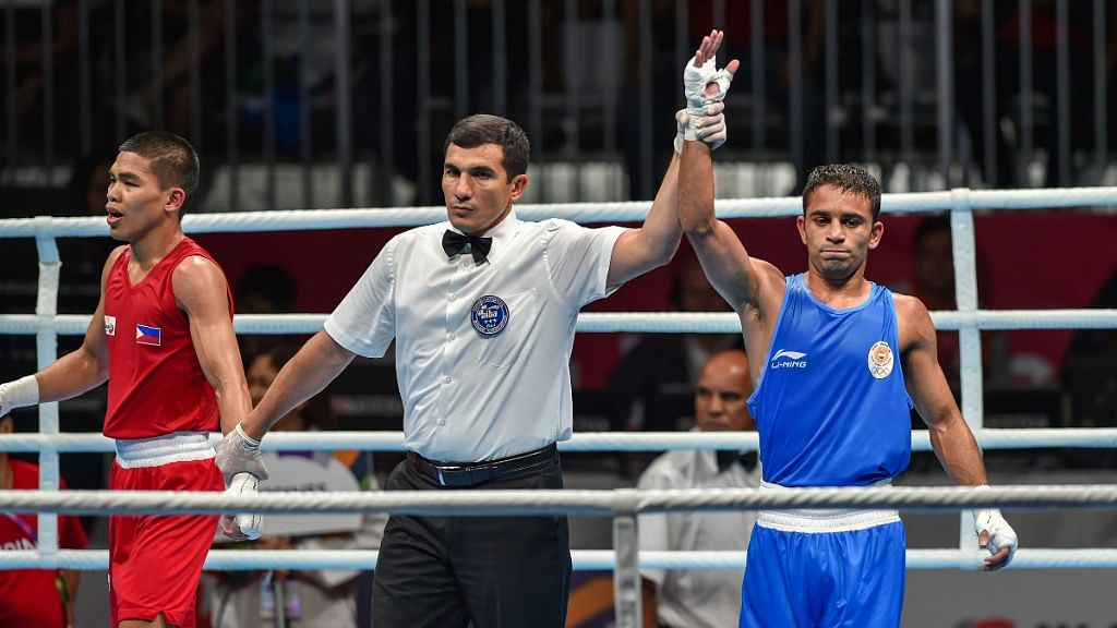 Amit beat Philippines' Carlo Paalam in a 3-2 verdict.