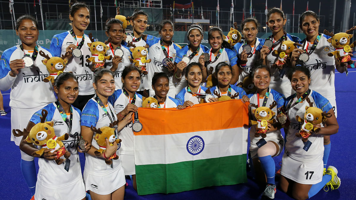 Silver medalist India's team pose for a group photo after ceremonies for the women's hockey match on Friday, 31 August.