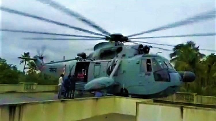 Navy Chopper Lands on Narrow Rooftop, Daringly Rescues  26 People