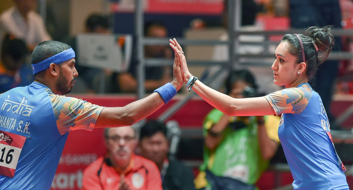 """<div class=""""paragraphs""""><p>File: India's Achanta Sharath and Manika Batra during the mixed-double table tennis match against Korea in the 18th Asian Games 2018 in Jakarta on Wednesday.</p></div>"""
