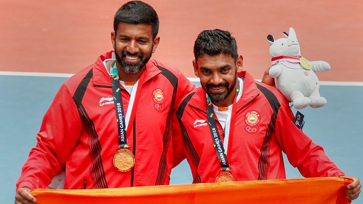 """<div class=""""paragraphs""""><p>File: Gold medalists Rohan Bopanna and Divij Sharan poses with the tricolour after the presentation ceremony for Men's Double event at 18th Asian Games Jakarta Palembang 2018.</p></div>"""