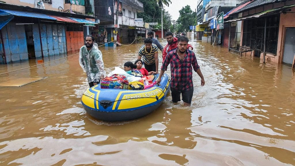 People being rescued from flood-affected regions following heavy monsoon rainfall, in Kochi on Saturday, 18 August, 2018.