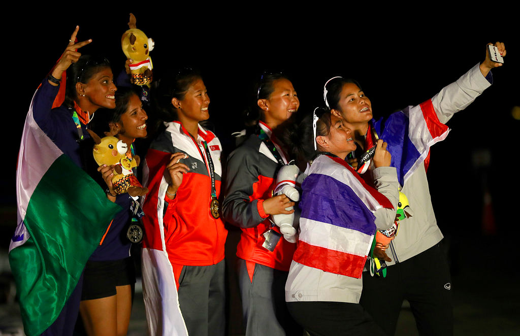 From left to right silver medalist Gautham Varsha and Shervegar Sweta of India, gold medalist Lim Min Kimberly and Low Rui Qi Cecilia of Singapore and bronze medalist Waiwai Nichpa and Klahan Kamonchanok of Thailand.
