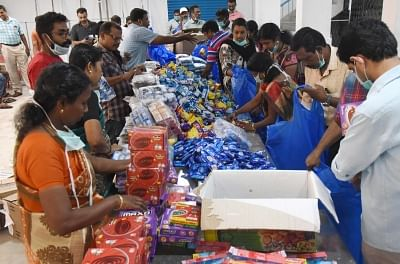 Kochi: Kochi corporation workers busy working at flood relief materials distribution center, in Kochi, on  Aug 22, 2018. (Photo: IANS)