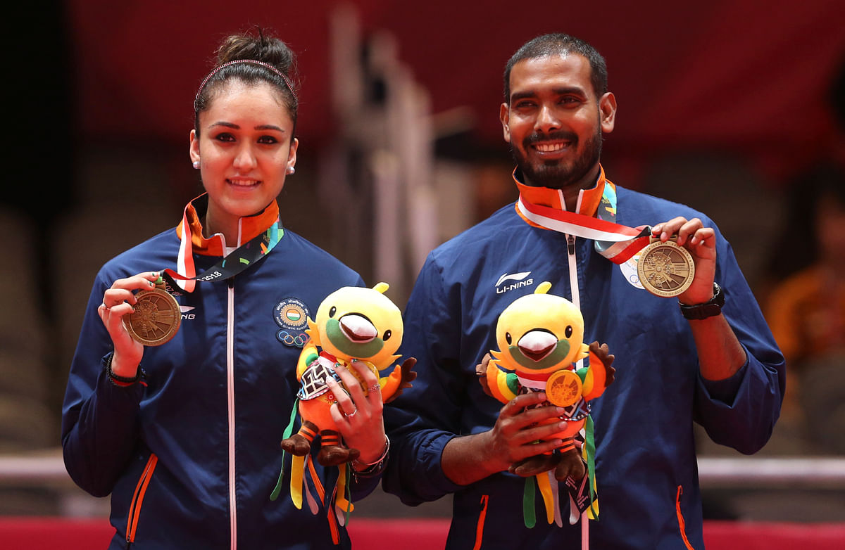 Manika Batra (L) and Sharat Kamal (R) after clinching bronze in their mixed doubles at the Jakarta Asian Games.