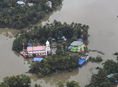 Kerala: An aerial view of the flood-hit areas of Kerala on Aug 18, 2018. Overflowing rivers and a series of landslides have caused the death of 180 people as of Saturday morning, with over three lakh people forced to move to some 2,000 relief camps. The disaster has triggered an unprecedented rescue and relief operation led by the Army, the Air Force and the Navy along with teams of National Disaster Response Force involving about 1,300 personnel and 435 boats. Prime Minister Narendra Modi on Sa