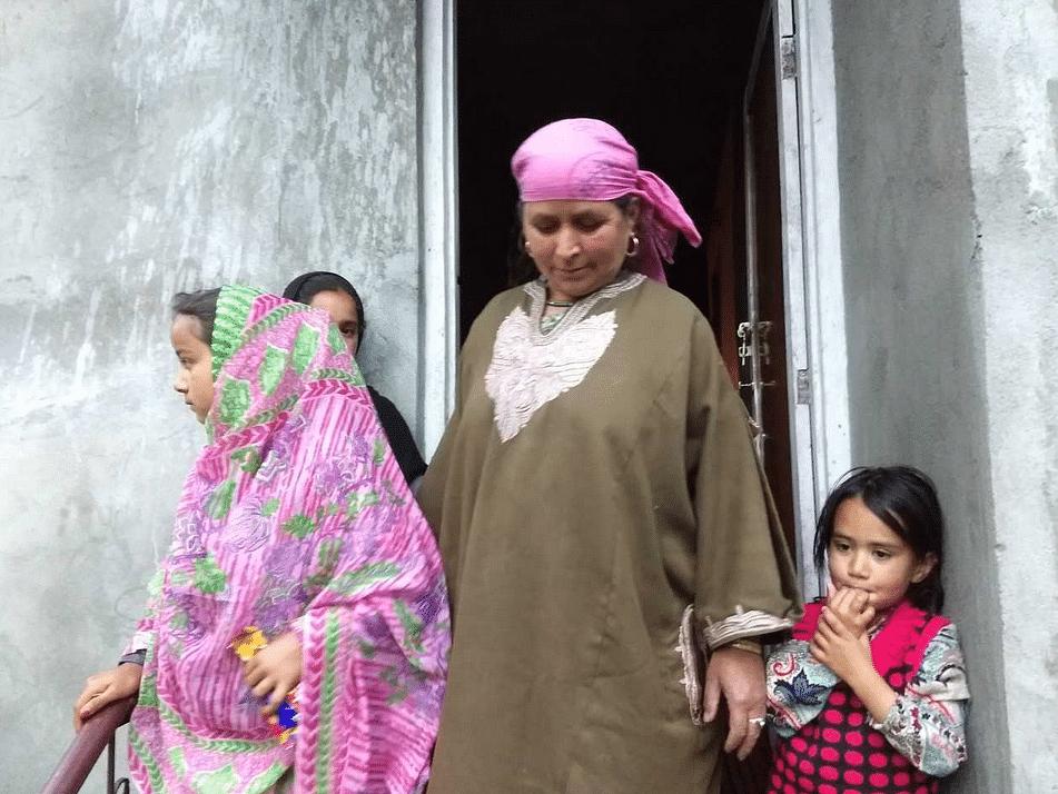 Saleema, mother of Altaf Kachroo outside their home in Hawoora Mishipora.
