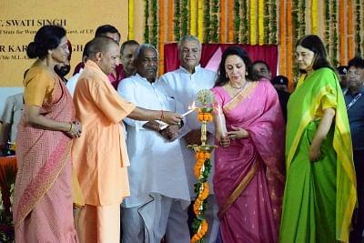 Vrindavan: Uttar Pradesh Chief Minister Yogi Adityanath, Union Women and Child Development Minister Maneka Gandhi, Uttar Pradesh Minister Rita Bahuguna Joshi and Mathura MP Hema Malini inaugurates a women