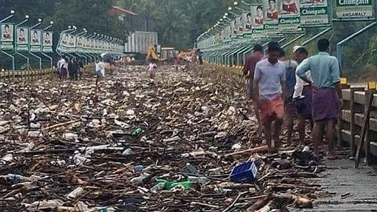 The Malayattoor-Kodanad bridge in the Ernakulam district was filled by garbage and filth after the water receded.
