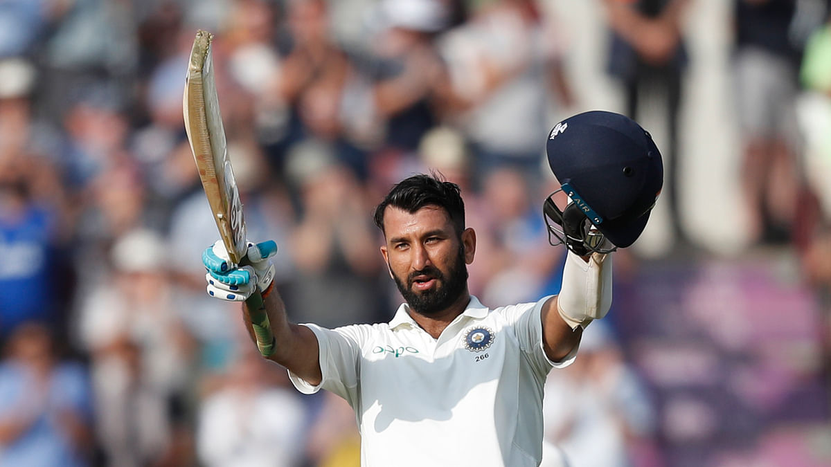 Cheteshwar Pujara celebrates getting 100 runs not out during play on the second day of the 4th cricket test match between England and India on Friday, 31 August.