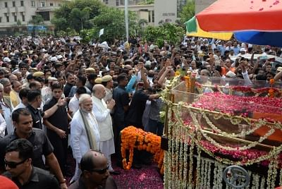 New Delhi: Prime Minister Narendra Modi and BJP chief Amit Shah walks along with the convoy carrying the mortal remains of former Prime Minister Atal Bihari Vajpayee; in New Delhi on Aug 17, 2018. (Photo: IANS)