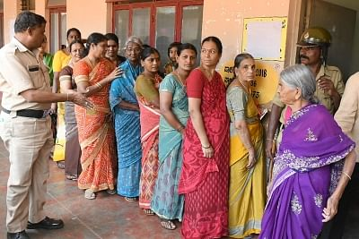 Mysuru: People queue-up outside a polling booth to cast their votes during local body polls in Karnataka