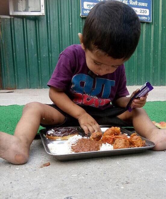 A little boy enjoys his meal.