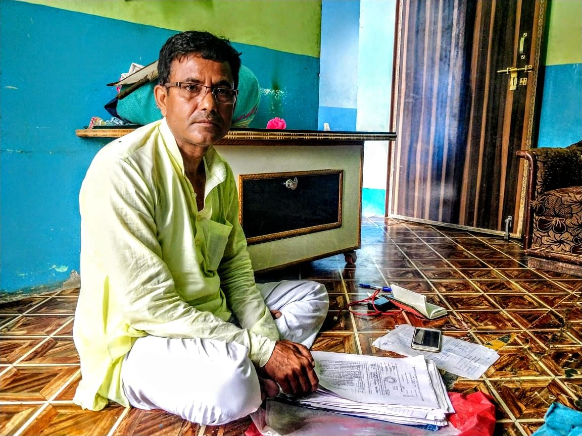 Naseem sitting in his home in Kairana. Here, he shows us the documents, including the FIRs for all the five cases.