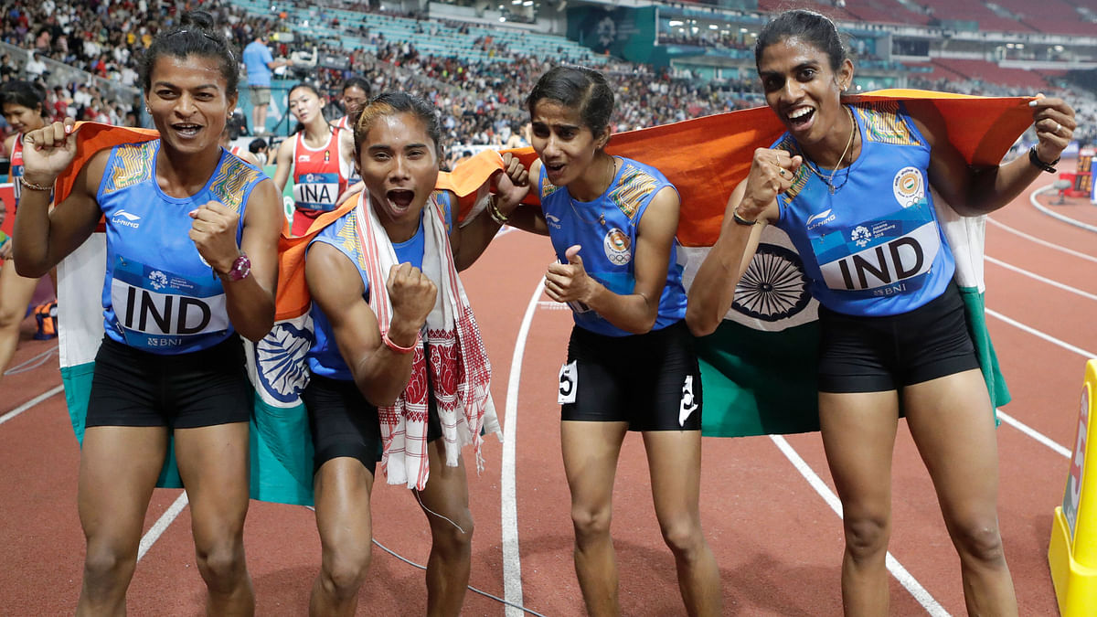 India's 4x400m relay team celebrate after winning the gold medal during the athletics competition at the 18th Asian Games.